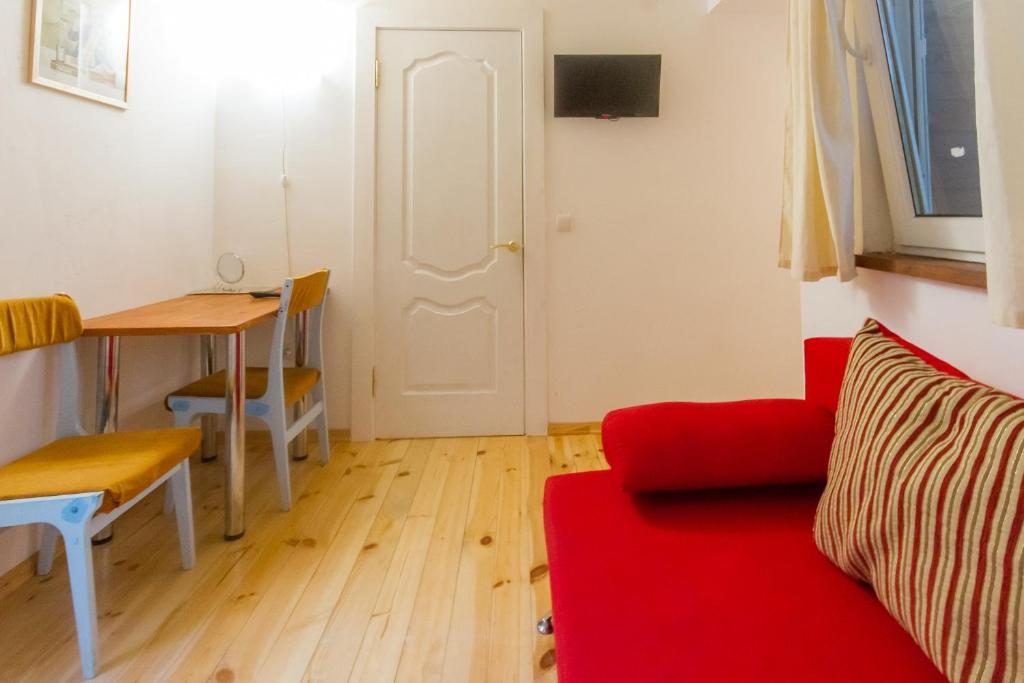 A seating area at Guest House on Tsvetochnaya st