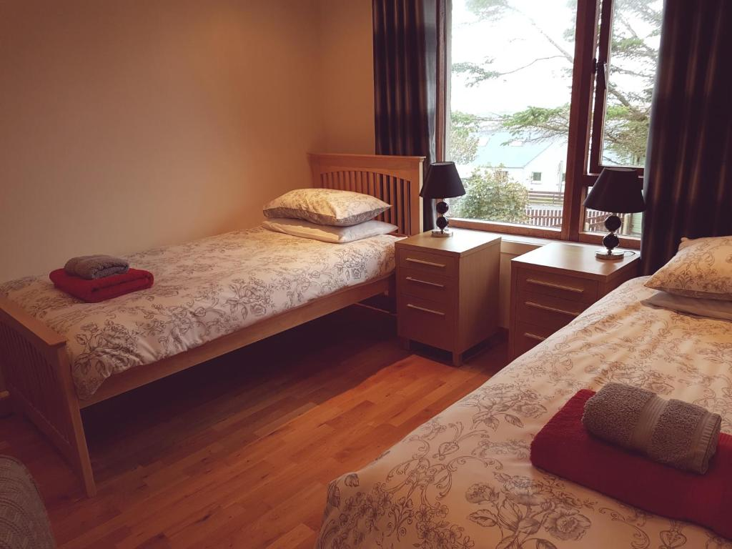 A bed or beds in a room at Studio @ 5 Upper Baila