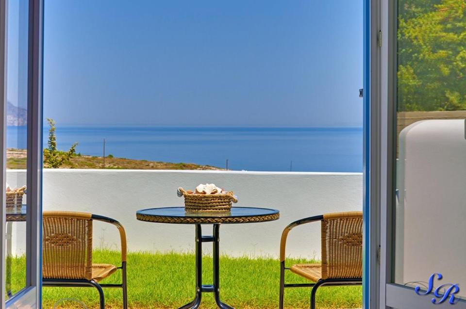 A porch or other outdoor area at Sarakiniko Rooms