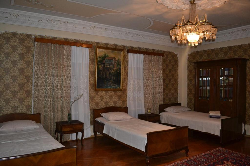 A bed or beds in a room at Guest House Slavyanka