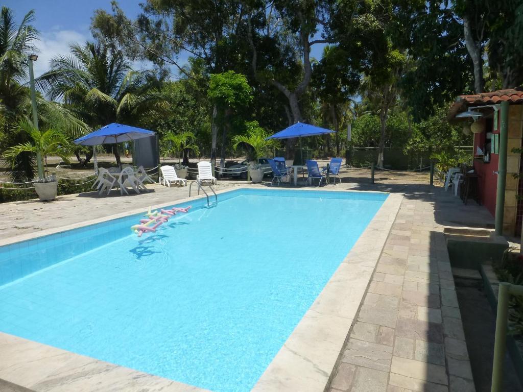 A piscina localizada em Pousada das Bromélias ou nos arredores