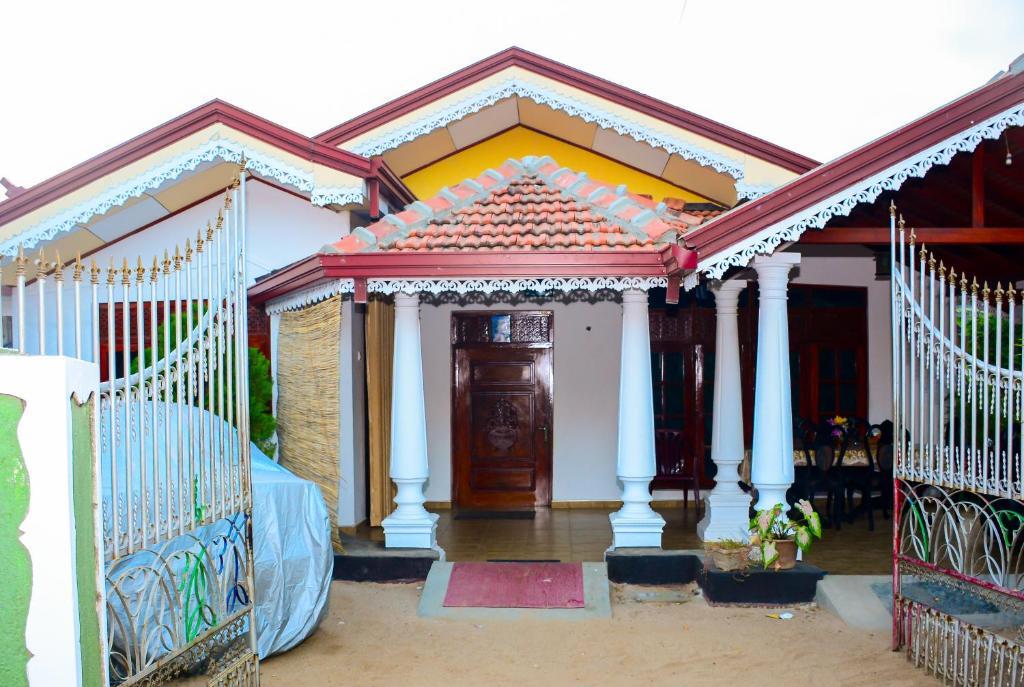 The facade or entrance of Lakshmi Family Villa