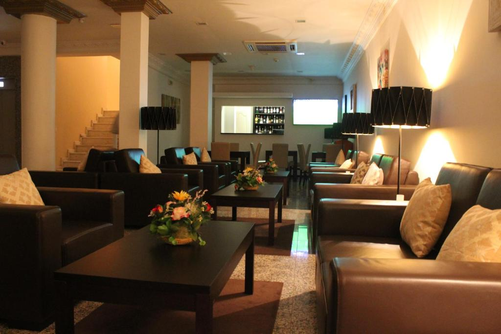 The lounge or bar area at Hotel Império