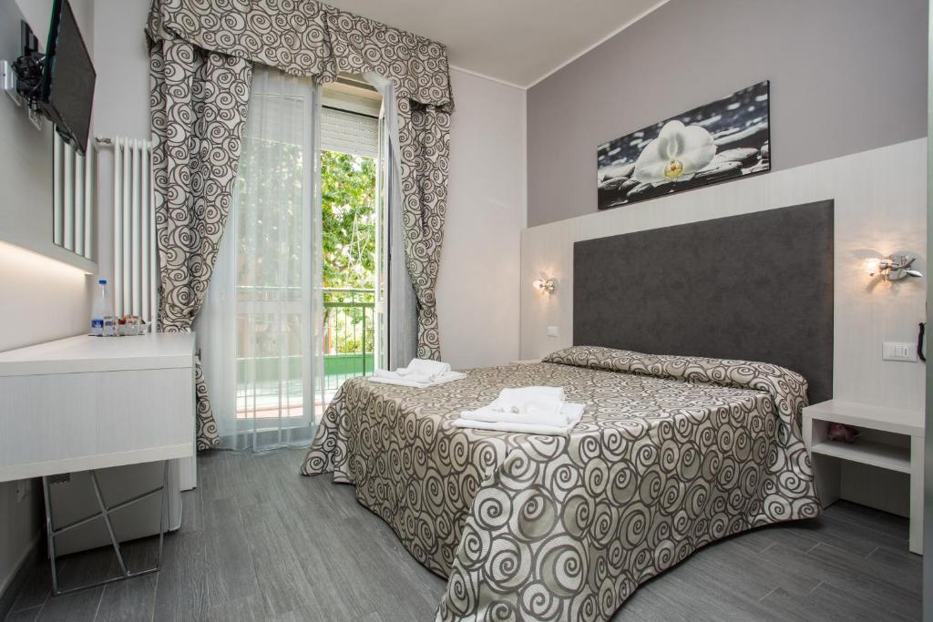 Кровать или кровати в номере Albergo Ristorante Pozzi