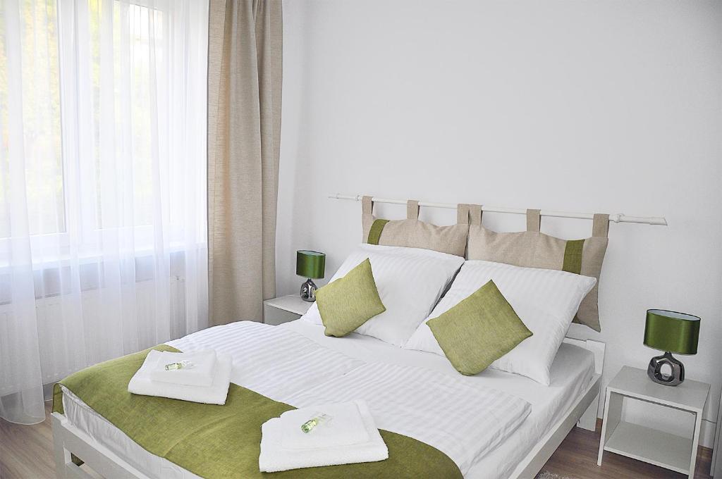 Łóżko lub łóżka w pokoju w obiekcie Apartament Rosa