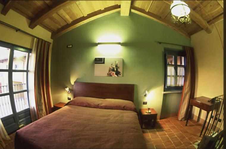Letto o letti in una camera di Albergo Ristorante Garibaldi