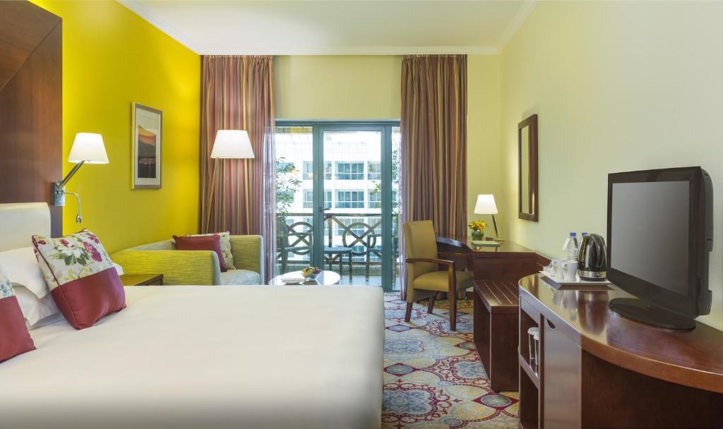 Een kamer bij Coral Dubai Deira Hotel