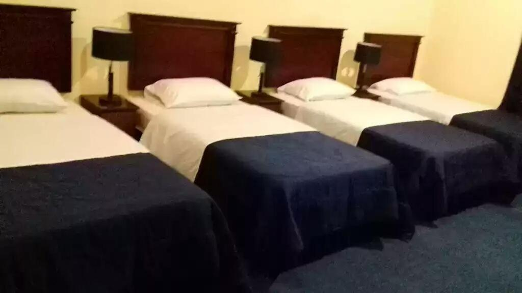 A bed or beds in a room at Helm Jeddah Hotel Apartments
