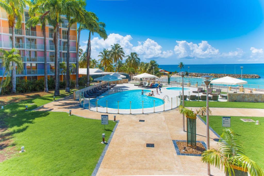 The swimming pool at or near Karibea Beach Hotel