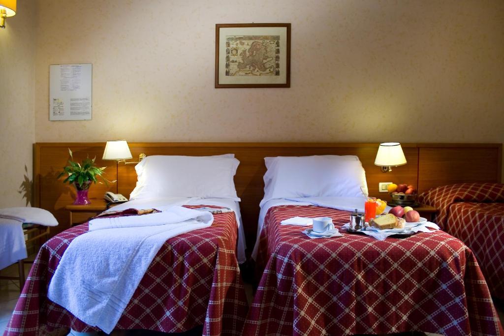 Кровать или кровати в номере Hotel Delle Muse