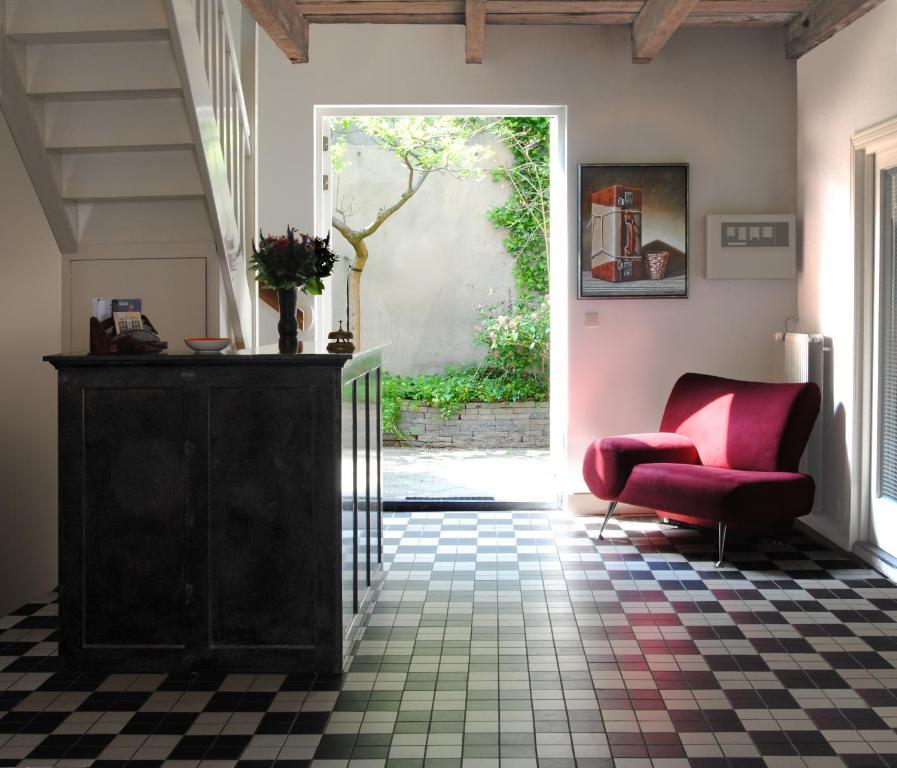 Лобби или стойка регистрации в Guesthouse De Utrechtsche Dom