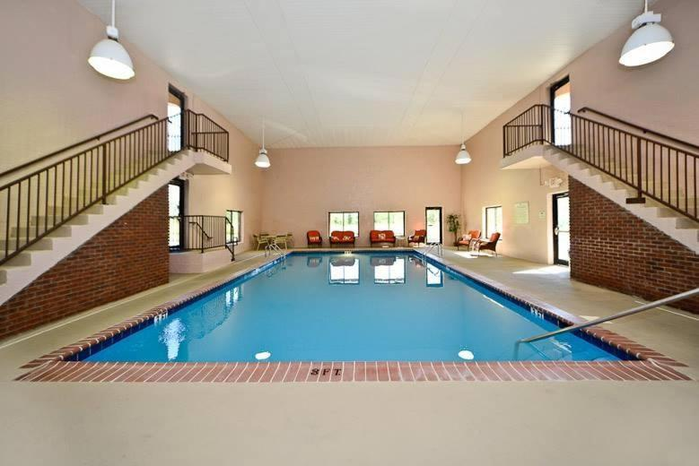 The swimming pool at or near Manchester Heritage Inn & Suites