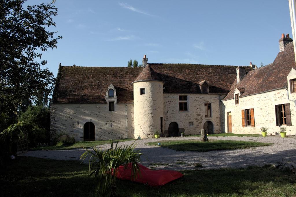 A garden outside Ferme-Château de Cordey & Spa
