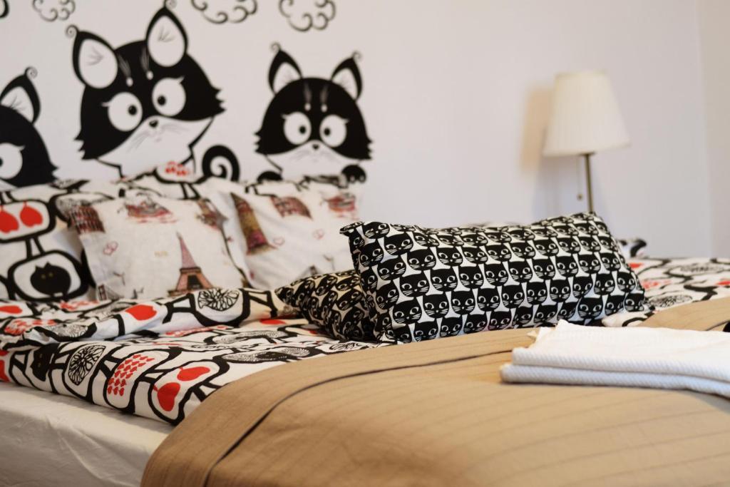 Un pat sau paturi într-o cameră la Citadel Hostel