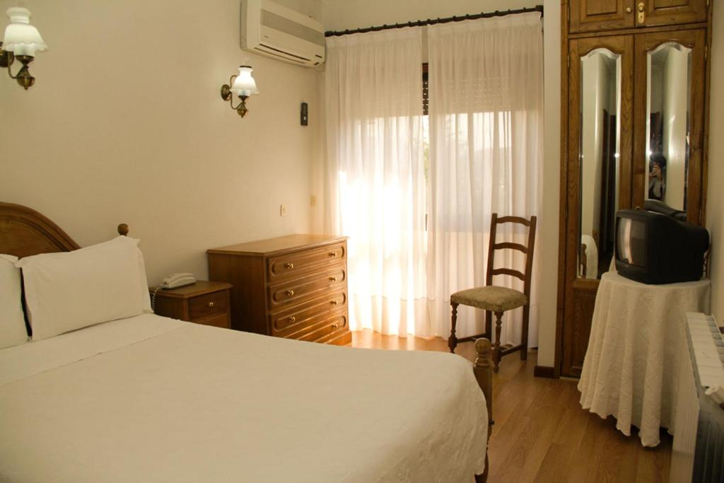 A bed or beds in a room at São Neutel