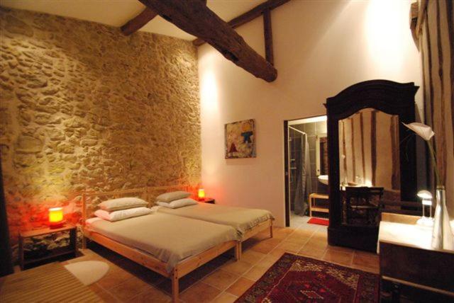 Un ou plusieurs lits dans un hébergement de l'établissement Domaine de Daran