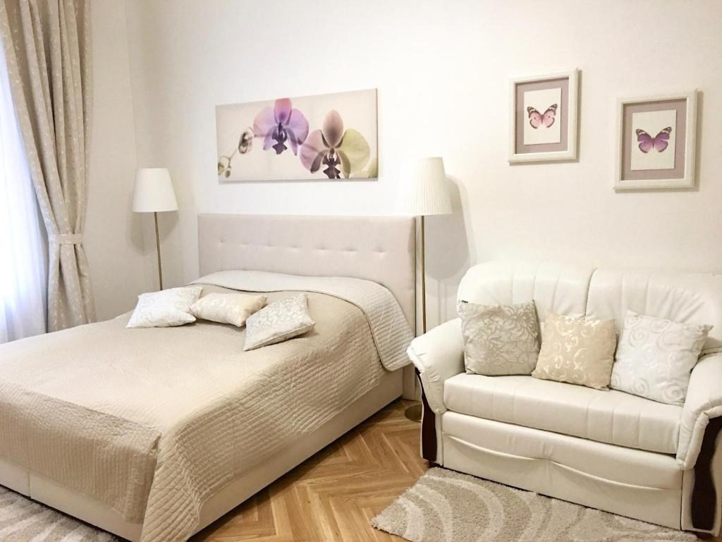Кровать или кровати в номере Apartment Bila Orchidej