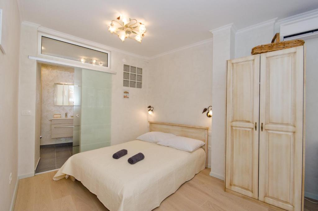 A bed or beds in a room at Casa Matteotti