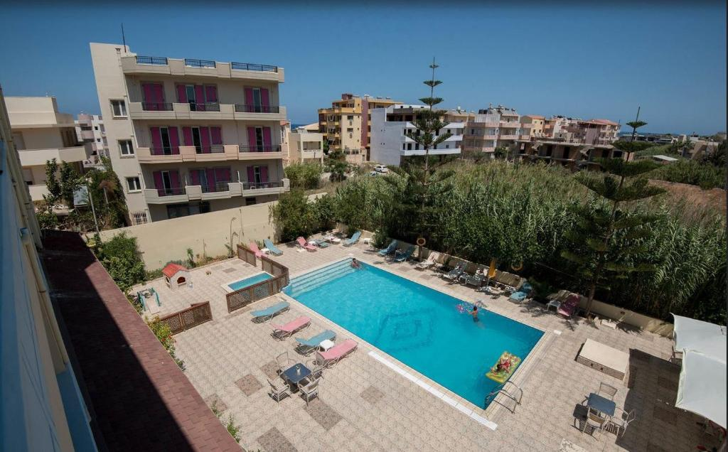 A view of the pool at Eleni Palace or nearby