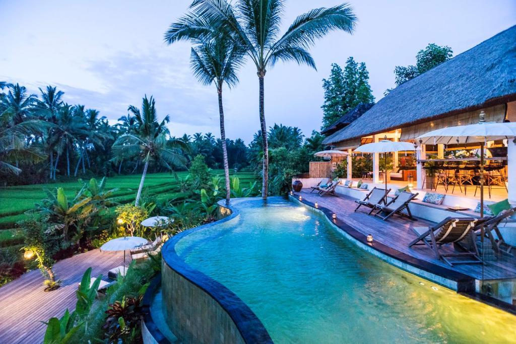 The swimming pool at or near Calma Ubud Suite & Villas
