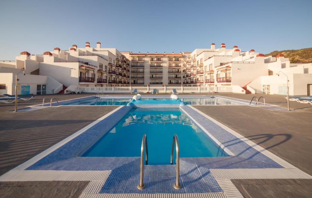 The swimming pool at or near Apartamentos Centro Cancajos