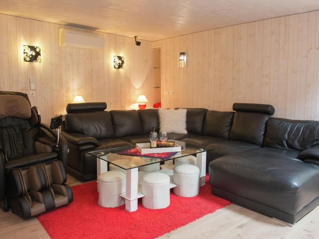 A seating area at Beautiful Apartment in Spa Belgium with Jacuzzi