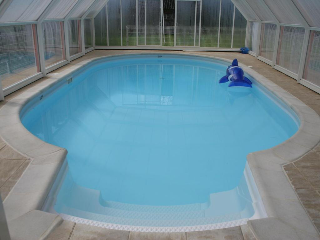 The swimming pool at or near Modern Holiday Home in La Foret-Fouesnant with Swimming Pool