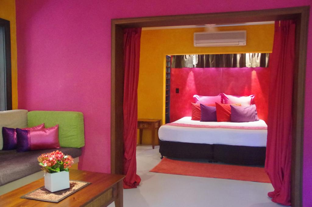 A bed or beds in a room at Pink Flamingo Resort
