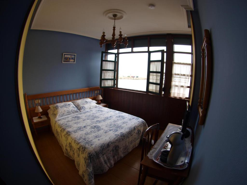 A bed or beds in a room at Hotel El Pescador