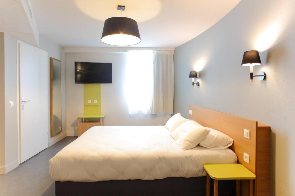 Кровать или кровати в номере Hotel Reseda
