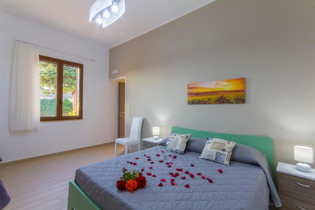 A bed or beds in a room at Vigne al Vento