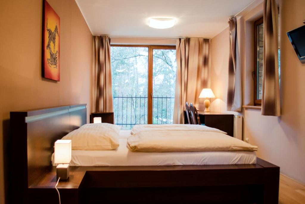 Postel nebo postele na pokoji v ubytování Penzion Archa - ZOO Olomouc