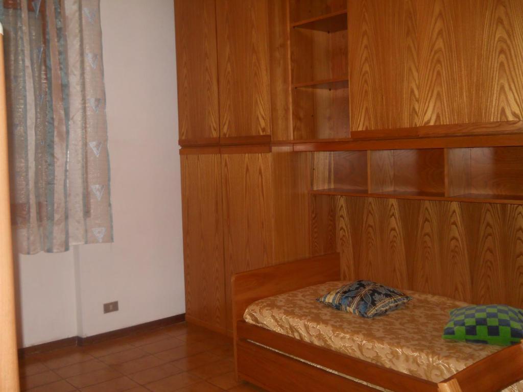Letto o letti in una camera di Condominio Portoro