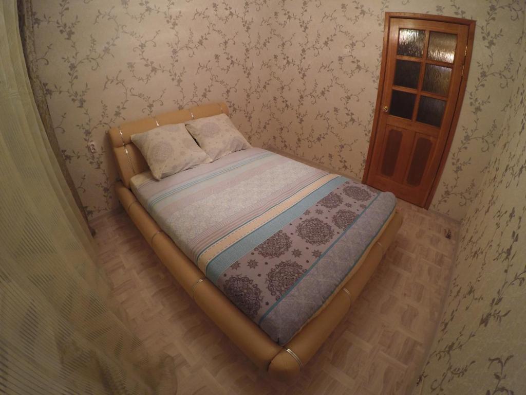 Кровать или кровати в номере Apartments on Orekhovom bulvare