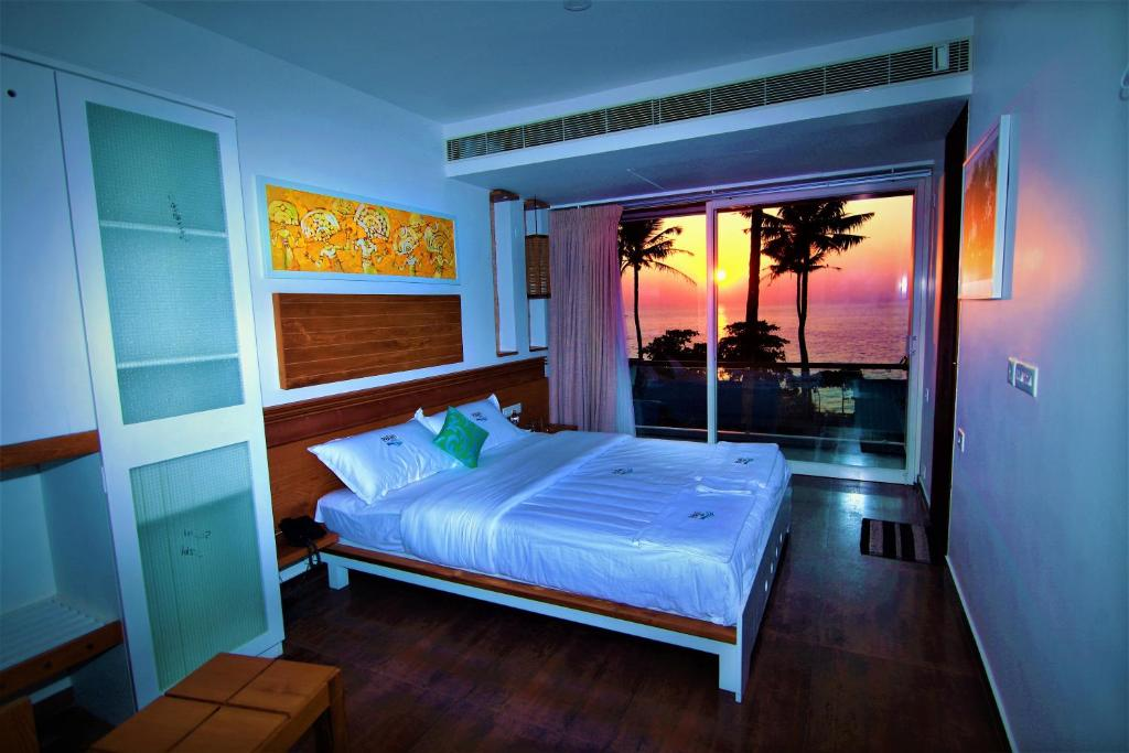 A bed or beds in a room at Palan Beach Resort