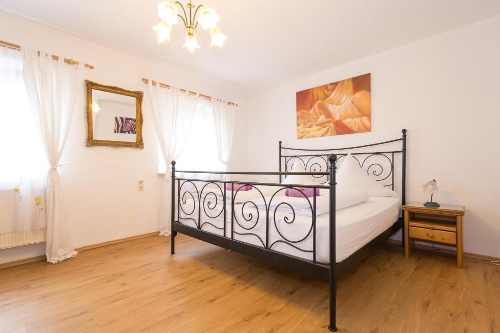 Postel nebo postele na pokoji v ubytování Hotel Moosbichl