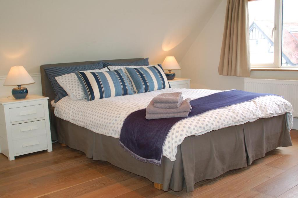 A bed or beds in a room at Brookview Guest House