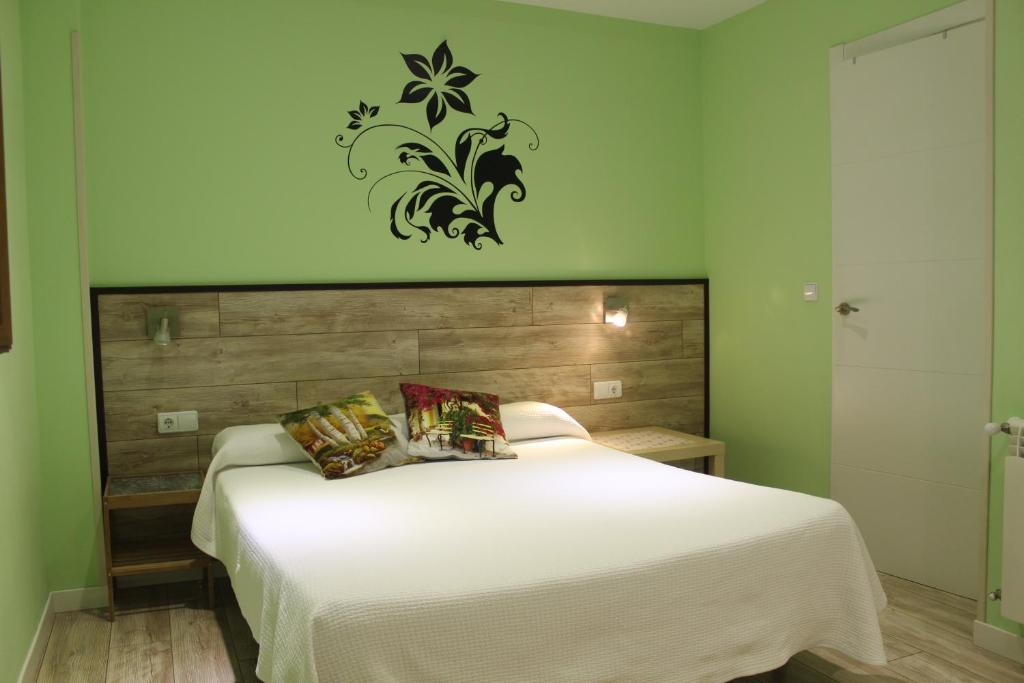 A bed or beds in a room at Blue Bilbao