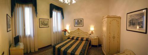A bed or beds in a room at Residenza Ae Ostreghe