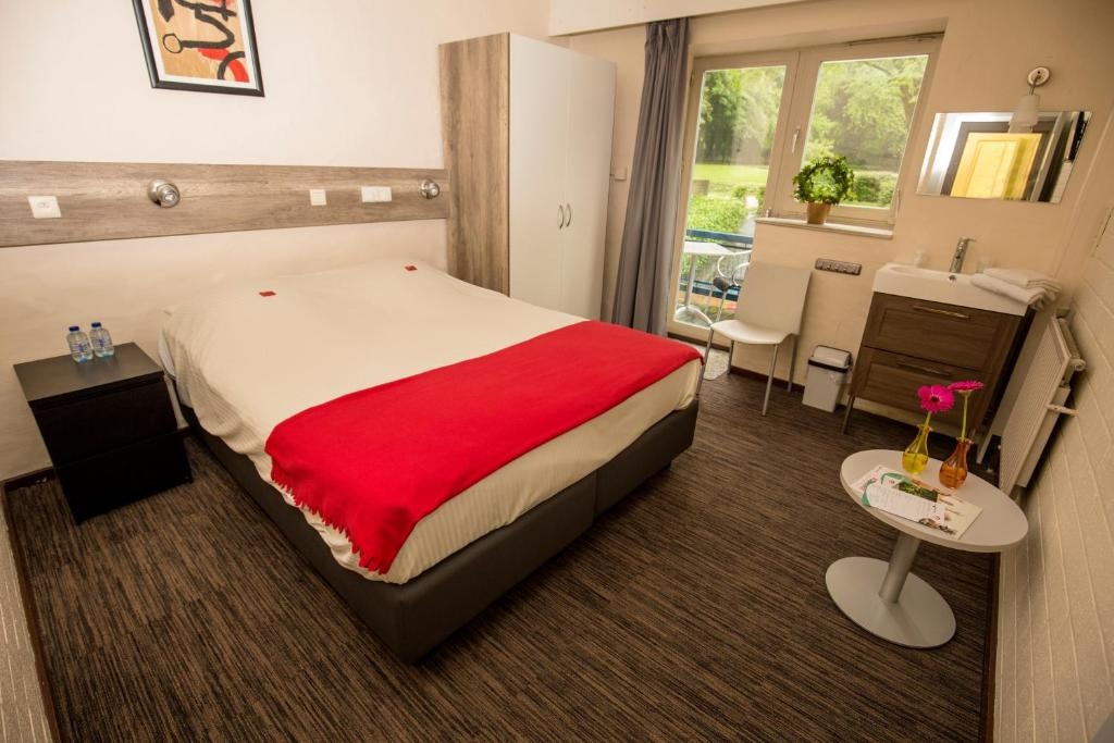 A bed or beds in a room at Vakantiecentrum Relaxhoris