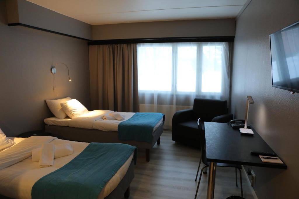 Säng eller sängar i ett rum på Hotel Nukkumatti
