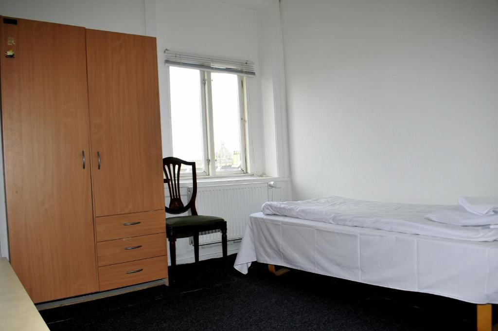 A bed or beds in a room at Hotel Euroglobe