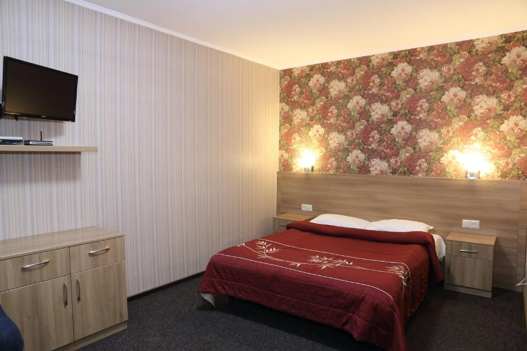 A bed or beds in a room at Ukrainian Hotel Service Apartments