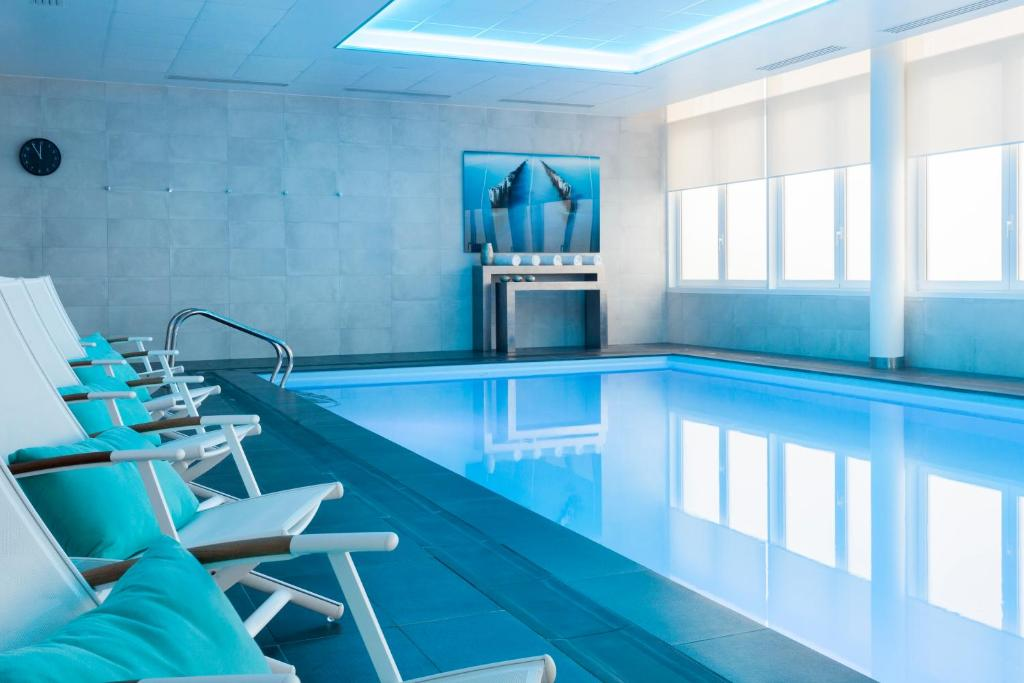 The swimming pool at or close to AC Hotel by Marriott Paris Le Bourget Airport