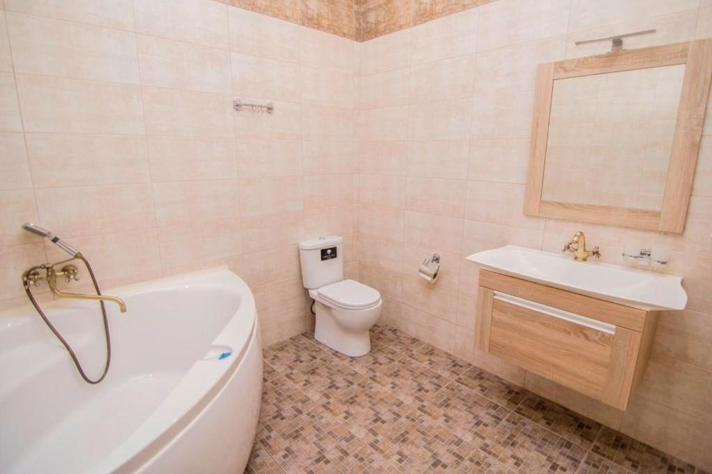 A bathroom at Apartment In Ideal House