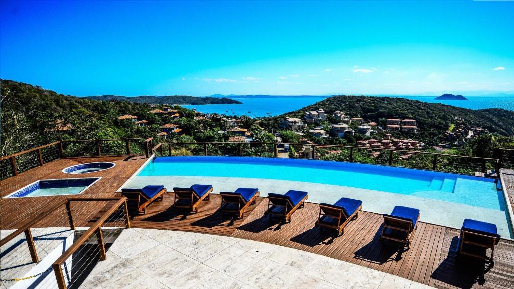 Uma vista da piscina em Apuã Boutique Hotel ou nos arredores