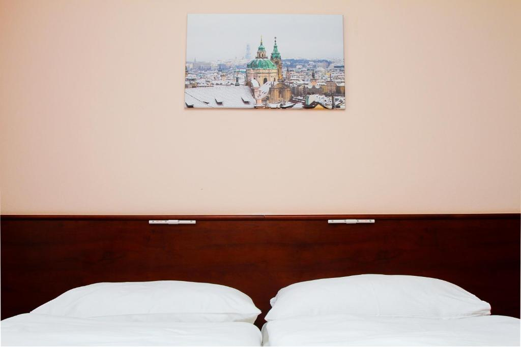 A bed or beds in a room at Hotel Inturprag