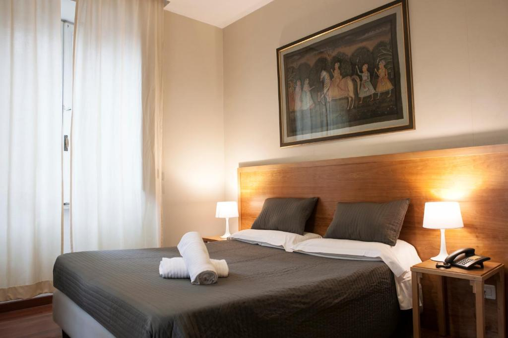 A bed or beds in a room at Hotel Terminal