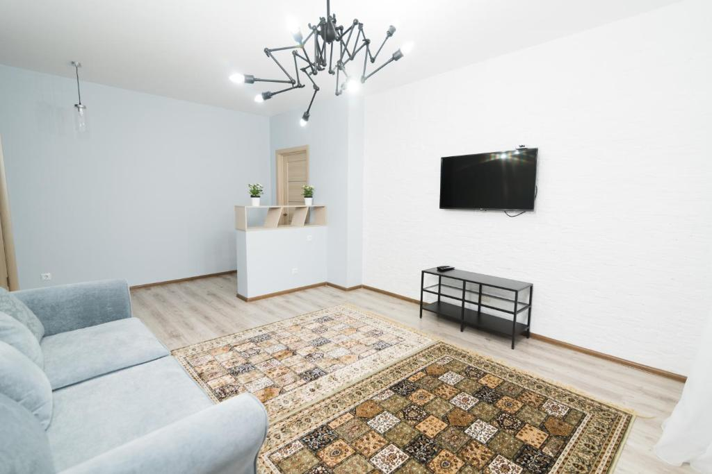 A television and/or entertainment center at The Room: apartment #39