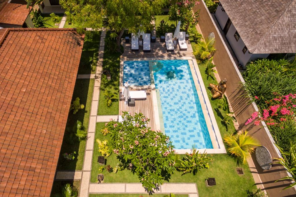 A view of the pool at Mimpi Nyata by Phocéa or nearby